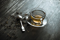 A cup of black tea with spoon Royalty Free Stock Image