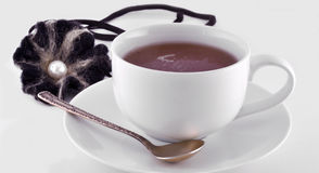 Cup of black tea and spoon Royalty Free Stock Images
