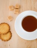 Cup of black tea, sugar and biscuits Royalty Free Stock Image