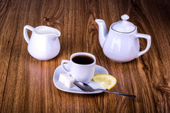 Cup of black tea with sugar and lemon Royalty Free Stock Image