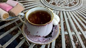 Cup of black tea with sweets Royalty Free Stock Photo