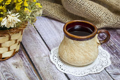 Cup of black tea. Black tea is on the table in the early morning Stock Image