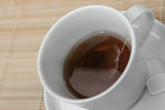 Cup of black tea with teabag inside Stock Images