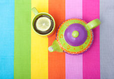 Cup of black tea with teapot Royalty Free Stock Images
