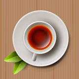 Cup of black tea, top view on cardboard Stock Photography
