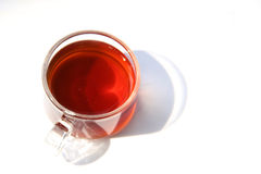 A cup of black tea under sunshine Royalty Free Stock Images