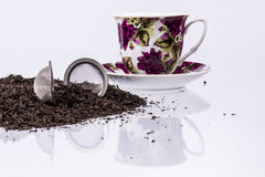 Cup and black tea on white background. Royalty Free Stock Photography