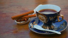 Cup of tea on the table with cinnamon and anise stock photos