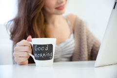 Cup with blank area for writing messages used by woman Stock Images