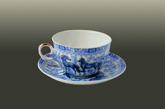 Cup with a blue pattern. Single cup painted under Gzhel Royalty Free Stock Images