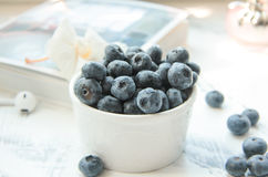 A Cup of blueberries. Fresh Blueberries in a white cup Royalty Free Stock Photography