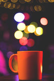 Cup with blurred light Royalty Free Stock Photography
