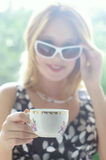 Cup with blurred woman  Royalty Free Stock Photography