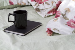 Cup book bed Royalty Free Stock Photos