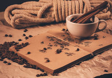 Cup on book with coffe beans and rope Royalty Free Stock Photos