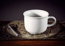 Cup  and book Stock Photography