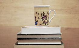 Cup on books Royalty Free Stock Photos