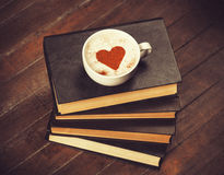 Cup with books Royalty Free Stock Photo
