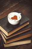 Cup with books Royalty Free Stock Photos