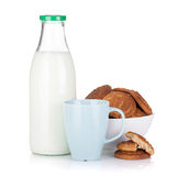Cup, bottle of milk and bowl with cookies Royalty Free Stock Image
