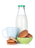 Cup, bottle of milk and cookies Stock Photo