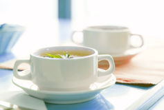 Cup of bouillon Stock Images