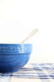Cup for breakfast with spoon, on white Royalty Free Stock Photos