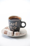 Cup of brewed coffee with Turkish delight on a plate Royalty Free Stock Image