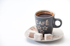 Cup of brewed coffee with Turkish delight on a plate Royalty Free Stock Images