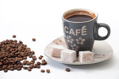 Cup of brewed coffee with Turkish delight on a plate and coffee Stock Images