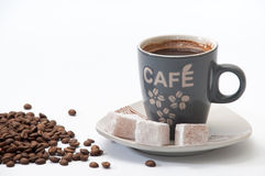 Cup of brewed coffee with Turkish delight on a plate and coffee Stock Image