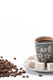 Cup of brewed coffee with Turkish delight on a plate and coffee Stock Photography