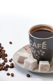 Cup of brewed coffee with Turkish delight on a plate and coffee Royalty Free Stock Photography