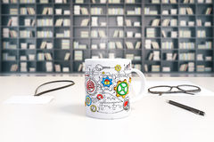 Cup with business scheme print on white table with glasses at bo Stock Images