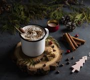Cup of cacao dark winter latte cappuchino christmas tree royalty free stock photography