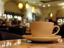Cup in cafe Stock Images
