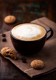 Cup of cafe au lait. And biscotti Royalty Free Stock Images
