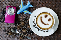 Cup of cafe latte with coffee beans and camera Stock Photography
