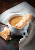 Cup of caffe crema with french pastries Royalty Free Stock Image