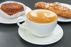 Cup of Caffe Latte with Pastry Background Royalty Free Stock Image