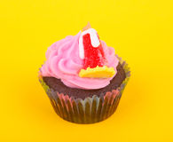 Cup cake. S isolated in yellow background Stock Photography