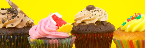 Cup cake. S isolated in yellow background Royalty Free Stock Image
