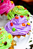 Cup cake. Purple cup cake with colorfull candy as toping Royalty Free Stock Photo