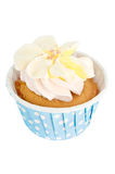 A Cup Cake. A cupcake with cream and some sugar in a blue paper cup Royalty Free Stock Images