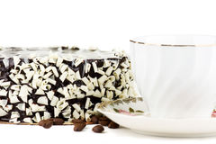 Cup and Cake. Cup with a cake in the background royalty free stock photography