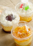 Cup cake and bakery. Cupcakes in a plastic cup and sweet bread Stock Image