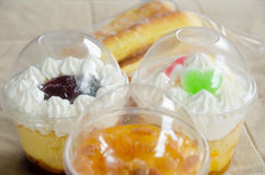 Cup cake and bakery. Cupcakes in a plastic cup and sweet bread Stock Photos
