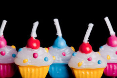Cup cake candles close up on black background Royalty Free Stock Photography