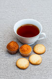 Cup cake, cookies and tea Stock Images