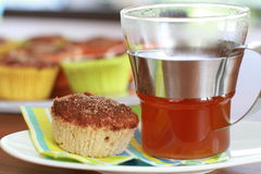 Cup cake with cup of tea Stock Photo
